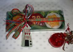 2017 Holiday Exclusive Gift Idea: Three Excellent Quality Natural Handmade glycerin Soaps ( a green, a red and a white, Christmas shapes and amber scent) in an green Christmas Handmade Gift Set with a lovely handmade glass Christmas Charm for Good Luck in the packaging.