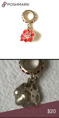 Chamilia Flower Charm Co designed with Swarovski this delicate dangling flower charm is made with .925 Sterling Silver and set with red and pink Swarovski crystal. Cute on a necklace or bracelet. Unworn sales sample. Fits Chamilia and Pandora Chamilia Jewelry Bracelets