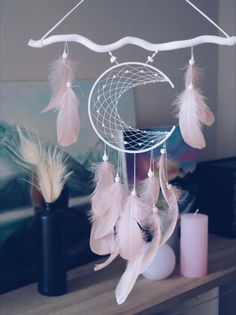 Moon dream catcher Wall hanging Room decor Dream catcher featuring a moon shaped frame with light pink tender feathers. You can choose the colour of the moon and stick, just contact me) Dream Catcher Decor, Dream Catchers, Dream Catcher Mobile, Dream Catcher Pink, Feather Dream Catcher, Moon Dreamcatcher, Diy And Crafts, Arts And Crafts, Unicorn Crafts
