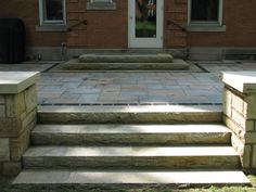 8' wide sandstone steps to patio.  Upper part of picture is steps to landing for door.