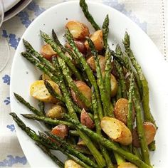 Rosemary Roasted Potatoes and Asparagus Recipe -Showcase asparagus when you dress it in fresh rosemary and red potatoes for an earthy counterpoint to the fresh, green spears. Add minced garlic and you get a gorgeous, flavorful side dish. —Trisha Kruse, Eagle, Idaho