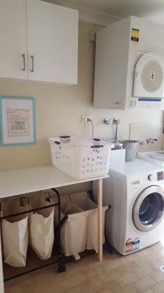 Laundry room update - folding table, shelving, diy signs and decor.