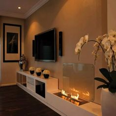 Decoration Ideas, Modern Fireplace Design With Fancy Large Television And Chic Face Sculpture Wooden Chair: Surprising Fireplaces Decoration for Minimalist Interior Design Home Living Room, Living Room Decor, Living Area, Home Interior Design, Interior Decorating, Decorating Ideas, Luxury Interior, Decor Ideas, Fireplace Design
