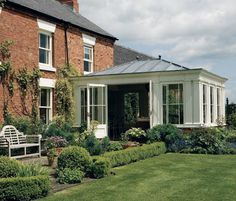 Garden access from the conservatory.love the white french doors and metal roof. Orangerie Extension, Conservatory Extension, Conservatory Kitchen, Garden Room Extensions, House Extensions, Roof Design, House Design, Porch Addition, Porch And Balcony