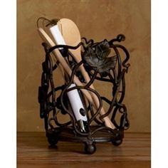 Hand forged wrought iron is skillfully crafted into a beautiful array of twining grapevines with detail so vivid you will think you walked into an Italian vineyard. Spiraling tendrils and intricately veined leaves display workmanship. Kitchen Themes, Kitchen Decor, Kitchen Ideas, Wine Themed Decor, Utensil Caddy, Kitchen Necessities, Tuscan Decorating, Decorating Ideas, Iron Decor