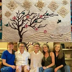 """Laurie's close friends surprised her yesterday with this quilt """"Pieces of our hearts."""" Across the top are the state quilt star blocks of Alabama North Carolina Connecticut (Laurie's birth state) and the home states of each of the friends. The wavy landscape contains 46 adjectives and phrases that describe Laurie. These Fab Five of art quilting are (L-R) Beth Inez Laurie Julie and Judy. What a touching and generous gesture to commemorate Laurie's farewell."""