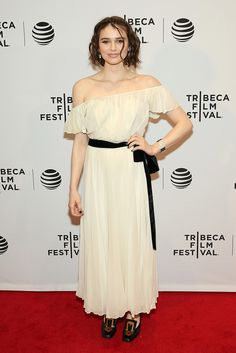 Take the off-shoulder trend to the next level with a boho cream dress in a gently pleated silk. With her loosely curled hair, actor Madeleine Coghlan looks like a goddess.