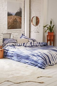 I love this blue Shibori Streak Jersey Duvet Cover, it works with lots of styles from boho to industrial to modern.   I'm not sure about the rest of the bedroom, love the walls and floors, but...