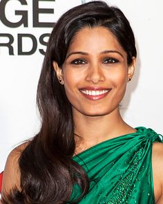 If you have naturally black hair like Freida Pinto, keep your undertones in mind and veer no more than two shades lighter so your hair stays in the same tonal family. I would suggest dark, chocolate brown highlights. Place the thickest pieces around the hairline to frame the face, then regress the highlights out in size toward the crown.
