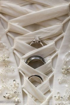 what a unique ring shot showcasing the rings and dress. Want to do this with my sister's dress at my wedding.