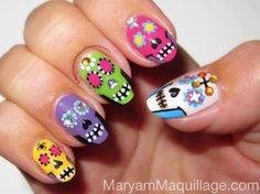 Sugar skulls look so sweet on any manicure.