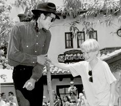 Pop star Michael Jackson at Disney-MGM Studios with Macaulay Culkin on June 24, 1991. Just outside the Brown Derby Restaurant.