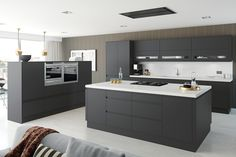Cheap Kitchens | Discount Kitchens for Sale Online | Cheap Kitchen Cabinets Matt Anthracite - The rich dark tones of our Moda matt Anthracite kitchen doors will add depth and decadence to any kitchen design. This bold and strong colour will definitely give your home the wow factor. This strong colour is enhanced by its sleek handleless appearance, making it perfect for any contemporary kitchen