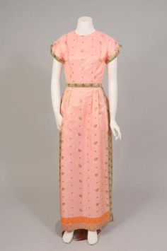 Tina Leser - In the 1950's she designed clothing using Indian Sari fabric for the garments. This peachy/pink silk dress is from that collection.