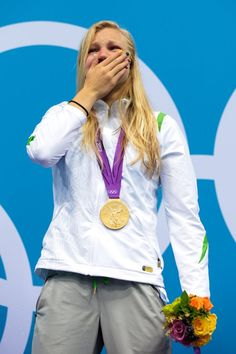 Day Three - JULY 30: Ruta Meilutyte of Lithuania reacts as she receives her gold medal during the medal ceremony for the Women's 100m Breaststroke on Day 3 of the London 2012 Olympic Games at the Aquatics Centre on July 30, 2012 in London, England. (Photo by Adam Pretty/Getty Images)