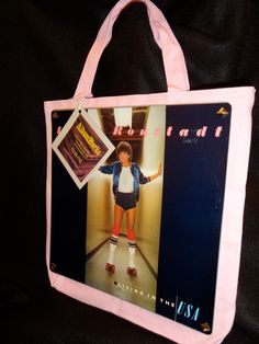 A personal favorite from my Etsy shop https://www.etsy.com/listing/165614418/linda-ronstadt-1978-back-in-the-usa