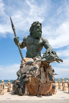 The King Neptune public statue welcomes visitors to Virginia's beach. The fence around it, to give an idea of scale, comes just above the average person's waist.