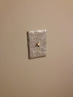Mod podge and glitter made this boring off white light switch pretty for my girl's nursery!