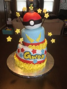 Pokemon birthday cake: This cake was for my grand-daughters birthday. Bottom tier was a chocolate cake with strawberry filling and the top tier was a lemon cake with lemon filling. The Pokemon ball was Rice Krispie Treats and chocolate. (Pokemon, topsy turvy.)