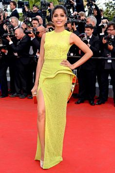 Freida Pinto is radiant in chartreuse Ateleir Versace at the Cannes premiere of 'Rust and Bone'!