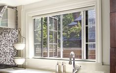 Serene retractable window screens by Phantom Screens on a casement window preserve the view while protecting from bugs and UV rays. #window #screen