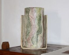 Lamp Manaar. Table lamp made with a mix of colors, which recalls the Apricena stone and the clear malachite.