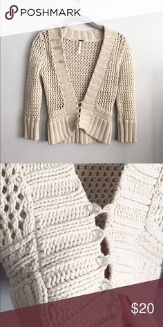 "Free People knit cream cardigan sweater M Free People knit cardigan sweater : semi cropped style, 3/4 sleeves with pearl button clasps at bottom. Size medium. Measurements are 18"" bust (when button unstretched), 21"" length. Free People Sweaters Cardigans"