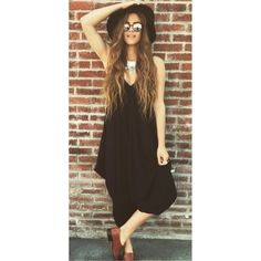 Black Harem Loose Drape Jumpsuit Size Medium Beautiful!  Black loose drape harem jumpsuit 95% Rayon 5% Spandex Blend.  Size Medium.  No Trades, Price Firm unless Bundled.  BUNDLE 3 OR MORE ITEMS FOR 15 % OFF Boutique Pants Jumpsuits & Rompers