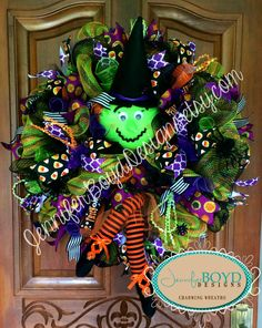 Halloween Witch and Legs Deco Mesh Wreath by Jennifer Boyd Designs.  Witch kit with face, hat and legs provided by Creative Gift Packaging.  www.etsy.com/shop/JenniferBoydDesigns www.facebook.com/JenniferBoydDesigns