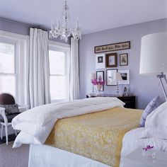 like this bedroom color.  I love the curtains hung ABOVE the window.  Makes it seem taller....