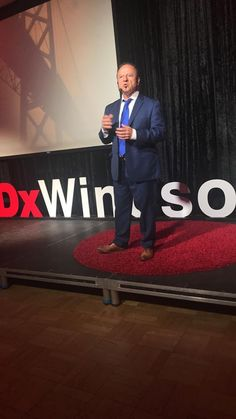 Hypnotist James Graham onstage at Windsor Ontario TedX event. James Graham, Windsor Ontario, Self Development, Ted, Presentation, Author, Entertaining, Funny, Entertainment