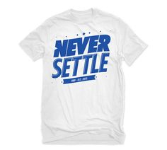 """Our White Text Graphic Tee - """"NEVER SETTLE""""...  It's a common theme for us when we're on the water chasing our DREAM.  Aim High and DREAM BIG!"""