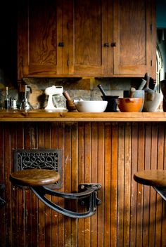 #kitchen .... love the stools mounted to the counter instead of floor... antique vent... beautiful patina on the wood