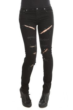 I want this so bad from hot topic black ripped skinny jeans with safety pins