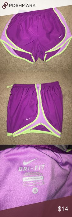 Nike women's Dri-Fit shorts Nike Dri-Fit Workout Shorts. The colors are purple and lime green outlined and the Nike swoosh is gray. The size is M is women's. They are very comfortable. Nike Shorts