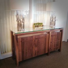 Canadian made by VerBois Furniture. ZIG Buffet in natural walnut. Available in a variety of stains. See in store for pricing and available options.