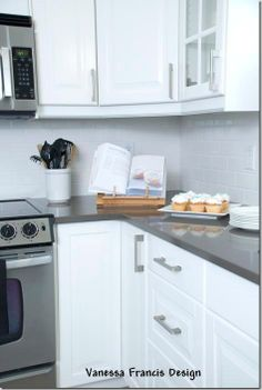 Ikea kitchen via Vanessa Francis Design. Hanstone Tiffany Grey, white subway tile.