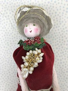 I made this lovely lady out of bits of vintage materials and added touches of wire and glitter and of course, a plethora of flowers! She has a cluster of pearls for a necklace and a dandy mushroom wreath to add to her festiveness. Alpaca fluff for her beautiful hair with a little white piece of vintage lace to add to her ornamental beauty. She is about 11 inches high and is filled with lavender so just give her a squeeze to emit the heavenly scent. Only one of a kind in the whole wide…