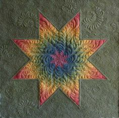 I like how the quilting on this star, treats each diamond as a unit. It's different visually than quilting each little diamond as its own space.