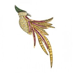 18K white gold bird brooch with 2.85ct yellow sapphires, 1.3ct emeralds, and 0.14ct rubies by Jye.