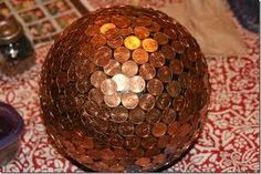 Bowling ball mosaic with pennies