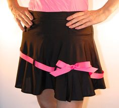 black with Yellow ribbon in place of pink  and black shorts / pockets  swing style