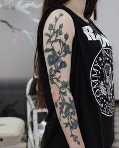 Botanical floral sleeve tattoo by Olga Nekrasova