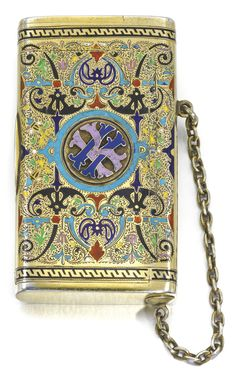 A SILVER-GILT AND CHAMPLEVÉ ENAMEL CIGARETTE CASE, ST PETERSBURG, 1878 the surface of polychrome strapwork and flourishes on a scroll-engraved ground, the lid applied with Cyrillic initials IK, the end with vesta compartment, struck with maker's mark KA, possibly for Karl Albrecht