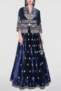 ANITA DONGRE Featuring a navy blue lehenga in velvet base with gota patti hand embroidery. It is paired with matching jacket blouse with a mandarin neckline, slit and three quarter sleeves and a dupatta in silk brocade base. Jacket Lehenga, Brocade Lehenga, Blue Lehenga, Lehenga Choli, Silk Brocade, Lehnga Dress, Dress Skirt, Indian Fashion Trends, Indian Designer Outfits
