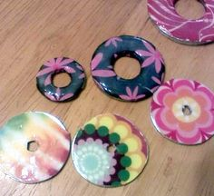 Cool necklace using a washer, Mod Podge and Glossy Accents. Oh yeah, and some pretty paper ;)