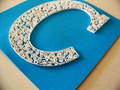 Quilling letters. Could make a really nice door sign for a kids room or the like.