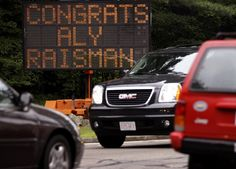 A construction sign recognizes the accomplishments of gymnast Aly Raisman in her hometown of Needham, Mass. , Wednesday, Aug. 1, 2012.