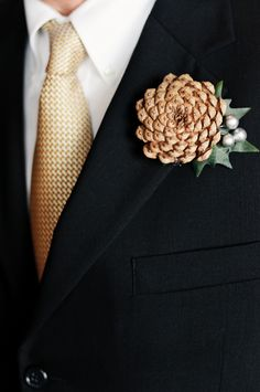 handmade pinecone boutonniere — photo by FS Weddings