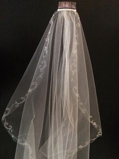 Beaded Chapel Length Veil. Beaded Chapel Length Veil on Tradesy Weddings (formerly Recycled Bride), the world's largest wedding marketplace. Price $150.00...Could You Get it For Less? Click Now to Find Out!